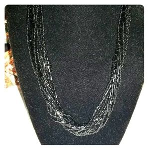 Black beaded twist necklace.